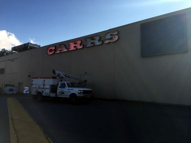 A & M Sign fixing Carrs neon light sign